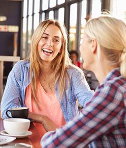 bigstock-Two-female-friends-talking-at--94342724